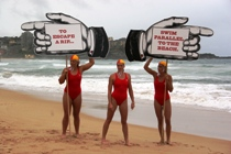 Surf lifesavers and Ironwomen (L-R) Naomi Flood, Liz Pluimers and Courtney Hancock launch the rips safety campaign.