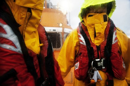 MS All-weather lifeboat crew in rain in new lifejacket Credit Nigel Millard